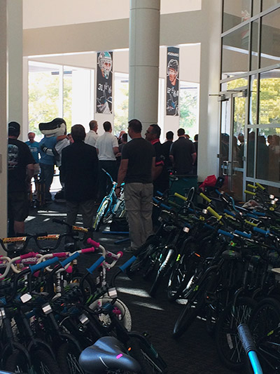 Sharkie giving away bikes.
